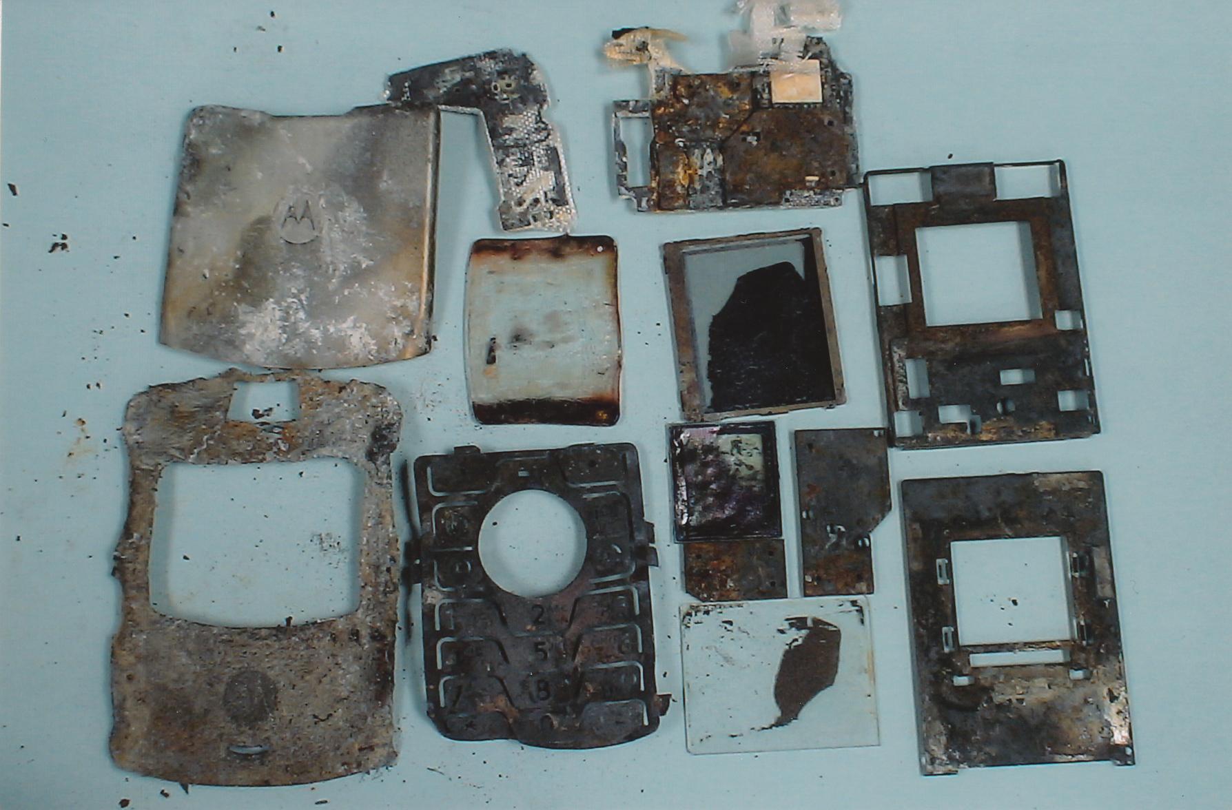 exhibit-412-burnt-cell-phone-pieces